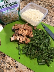 Chop leftover sesame tofu and green beans.